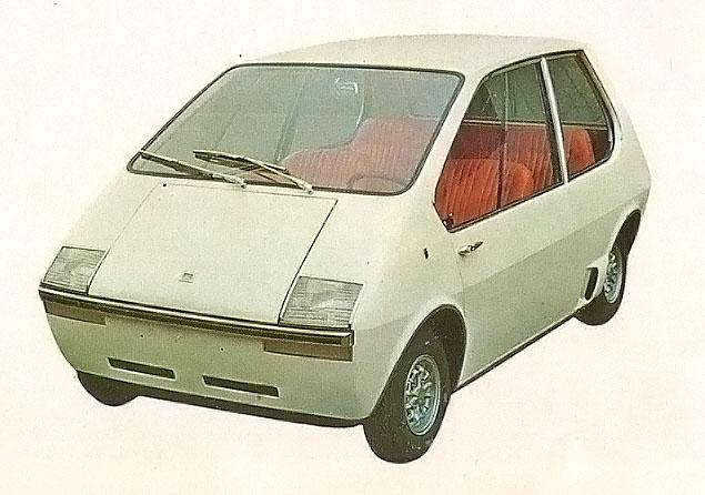 Rowan de De Tomaso de 1967 con dos motores eléctricos en las ruedas delanteras. La fotografía está tomada de la Enciclopedia Salvat del Automóvil, Volumen 2, 1974.