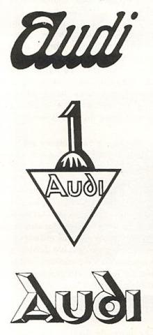 Los emblemas de la marca Audi que se usaron en los automóviles. El que se encuentra en el centro responde a las victorias en las carreras de los Alpes. Los emblemas de Audi fueron tomados de la Enciclopedia Salvat del Automóvil de 1974.